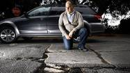 A drive along Angus Street in hilly Silver Lake requires navigating a gantlet of buckled concrete slabs and dirt-filled cracks.