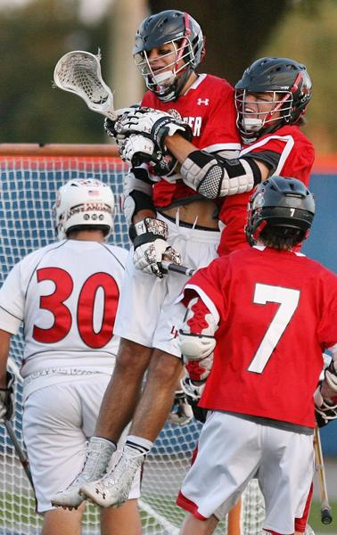 Lake Highland Prep's Will Wolfson (top) celebrates with teammates after scoring a goal during the FHSAA Lacrosse Championship game of Lake Highland Prep versus St. Andrews at West Orange High School in Winter Garden on Saturday, May 4, 2013.