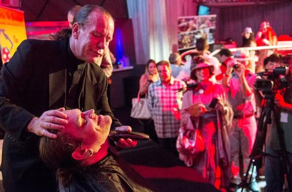 Darren Perlmutter gets a shave from Ken Bourke during The Ann Storck Center's 5th Annual Rock The Race at Passion Night Club in Hollywood.