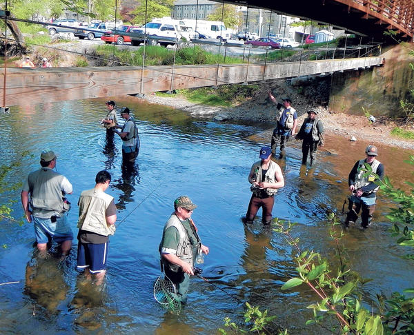 Anglers fish the Conococheague Creek at Wilson College in Chambersburg, Pa., on Saturday hoping to catch a tagged fish that could land them a prize in the annual Noontime Lions Trout Derby.