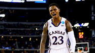The former AAU coach for Kansas star Ben McLemore claims he received thousands of dollars in cash and other benefits to steer McLemore to sports agents and financial advisors during the past college basketball season, according to a story Saturday on USAToday.com.