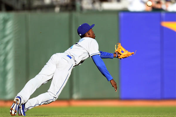 Dodgers shortstop Dee Gordon dives for a short fly ball that goes for a double off the bat of San Francisco's Angel Pagan on Friday night.