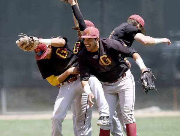 Glendale College players celebrate a win over Grossmont College in the the California Community College Athletic Assn. Baseball Southern Regional Championship at Stengel Field.