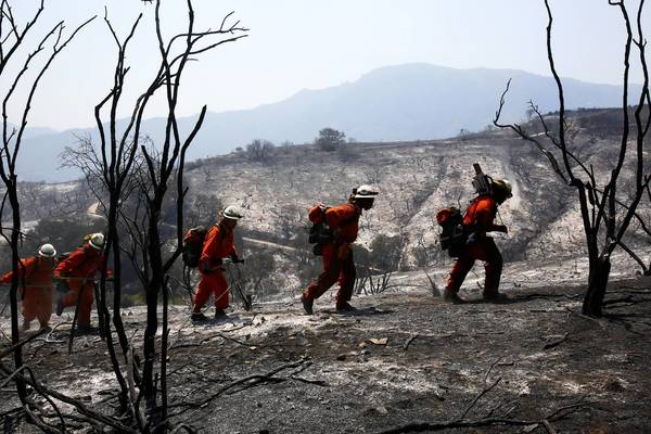Fire crews trudge through the burned area looking for hot spots, their battle against the Springs fire in Ventura County having abruptly turned into mostly a mop-up operation.