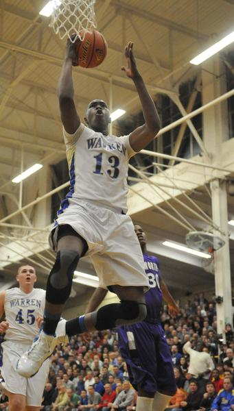 Warren's Darius Paul is defended by Niles North during the 4A Waukegan boys Supersectional game.