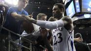 The University of Kansas is investigating a report that former KU guard Ben McLemore's AAU coach and mentor received payments from a sports agency.