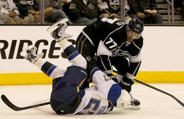 L.A. Kings' Jeff Carter checks St. Louis Blues' David Perron during the second period
