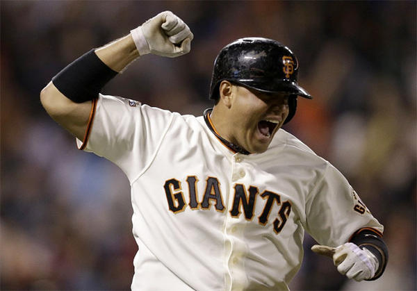 San Francisco Giants' Guillermo Quiroz celebrates as he rounds the bases after hitting a walkoff home run in the 10th inning against the Dodgers.