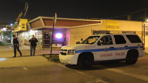A woman was shot here, in the 6000 block of Kedzie Avenue, on Saturday night. (Peter Nickeas / Chicago Tribune)