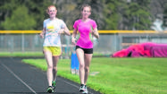 SOUTH BEND -- Adams High School students Michaela Lewis and Aubrey Curl have now completed a couple of runs through the winding trails at the pastoral grounds of Hannah & Friends, carefully measuring the 3.1 miles on their GPS watches.