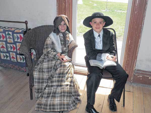 Siblings Anna and Jonathan Leach portray two of their ancestors, Sarah Ann and James E. Bonine, during a re-enactment actitvity at Bonine House.