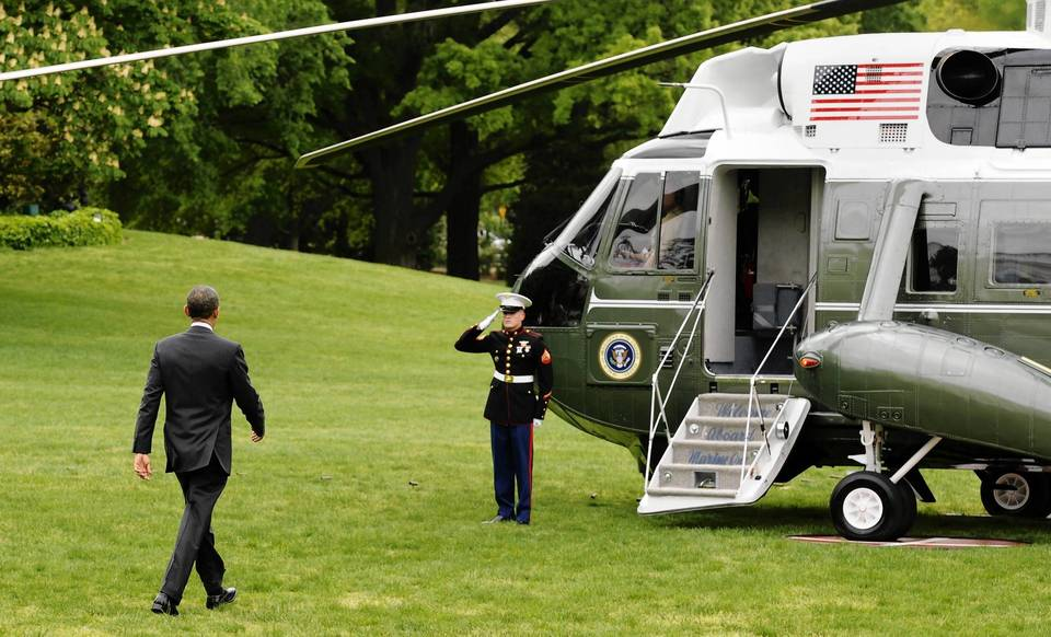 President Barack Obama walks to Marine One helicopter as he departs for a day trip to Columbus, Ohio.