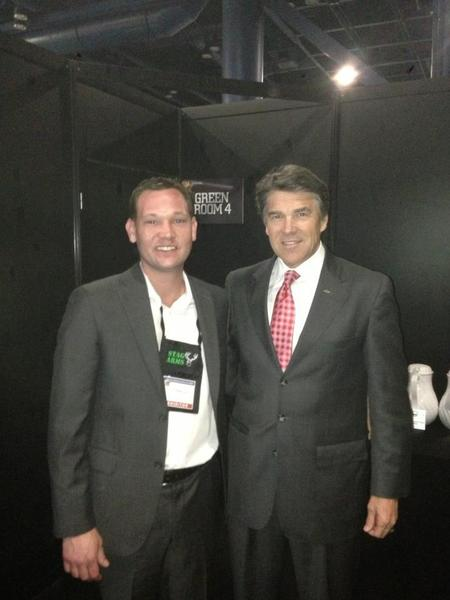 Mark Malkowsi, left, with Texas Gox. Rick Perry