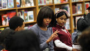 "First Lady Michelle Obama said the nation has to ""embrace"" youths whose lives are surrounded by violence and ""let them know we hear"" their concerns."