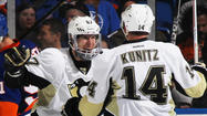 UNIONDALE, N.Y. -- Chris Kunitz scored a power-play goal 8:44 into overtime Sunday afternoon to lift the Pittsburgh Penguins to a 5-4 victory over the New York Islanders in Game 3 of the Eastern Conference quarterfinals at Nassau Coliseum.