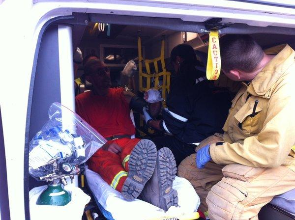An injured member of a fire crew gets medical attention in the Hidden Valley area of Ventura County.
