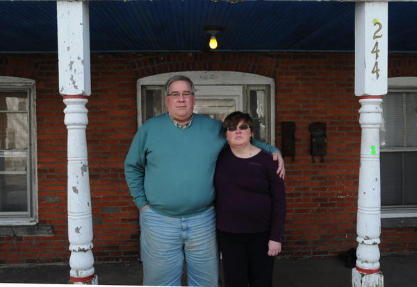 Dianne and Mark Doyle are both in their late 50s and both out of work. They are photographed at their home in Willimantic. Mark lost his job in August. He was a salesman. Dianne lost her job of more than 20 years in October. She was a bank branch manager.