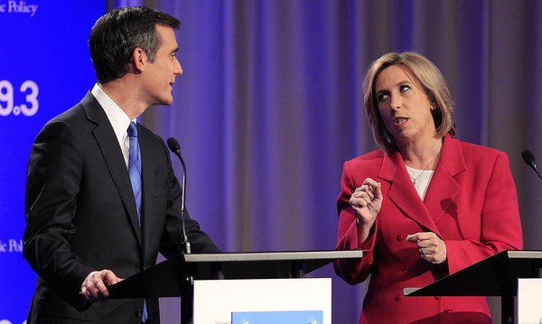 Los Angeles mayoral candidates Wendy Greuel, right, and Eric Garcetti chat before they squared off in a debate at the Louis B. Mayer Auditorium at USC's Health Sciences Campus.