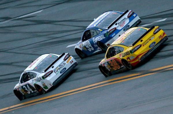 NASCAR river David Ragan (34) passes Carl Edwards (99) with the help of teammate David Gilliland (38) on the last lap Sunday at Talladega Superspeedway.