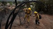 Hundreds of battle-wary firefighters made the transition to mop-up mode Sunday as the 28,000-acre Springs fire in Ventura County was declared 75% contained, with full containment expected Monday.