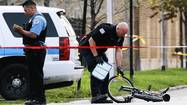 A teenaged gunman on a bicycle who officials said was firing shots at pedestrians and police officers was fatally shot by police this afternoon on the West Side, according to authorities.