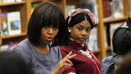 "First lady Michelle Obama said the nation has to embrace youths whose lives are surrounded by violence and ""let them know we hear"" their concerns."