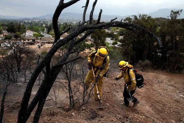 Crews shift to mop-up operations at the Springs fire in Ventura County, aided by cooler, damper weather. Full containment is expected Monday.