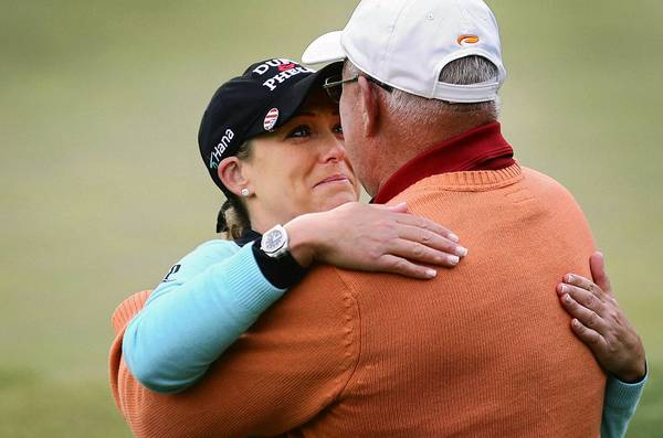 Cristie Kerr hugs her father Michael after winning the Kingsmill Championship Sunday in Williamsburg. This was the first time her father and been present when she won a tournament.