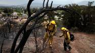 Hundreds of battle-weary firefighters made the transition to mop-up mode Sunday as the 28,000-acre Springs fire in Ventura County was declared 75% contained, with full containment expected Monday.