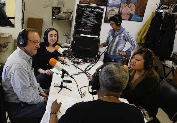 The closing of the Red Line's Dan Ryan branch was the subject of a recent radio show from Carter's Barbershop hosted by Richard Steele, foreground, and including activists and the Tribune's Jon Hilkevitch.