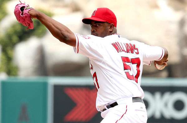 Angels starting pitcher Jerome Williams went from winner to loser when he issued walks followed by home runs in the fourth and fifth innings.