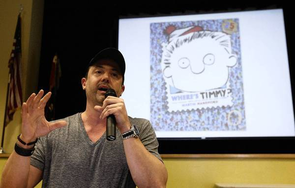 """""""Pearls Before Swine"""" cartoonist Stephan Pastis talks to pupils at Carver Elementary School in San Marino, his alma mater, about his illustrated book, """"Timmy Failure."""""""