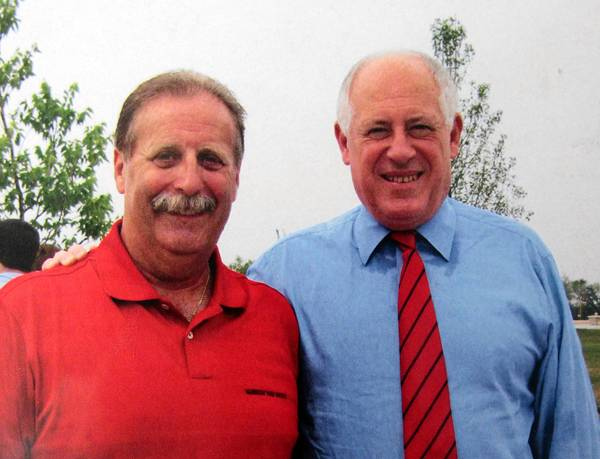 Waukegan Mayor Wayne Motley, seen here with Gov. Pat Quinn, campaigned in support of a local casino.