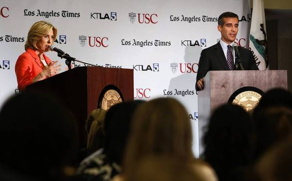 City Controller Wendy Greuel, left, and City Councilman Eric Garcetti met Sunday night at USC's Galen Center in a debate and town hall sponsored by the Los Angeles Times.
