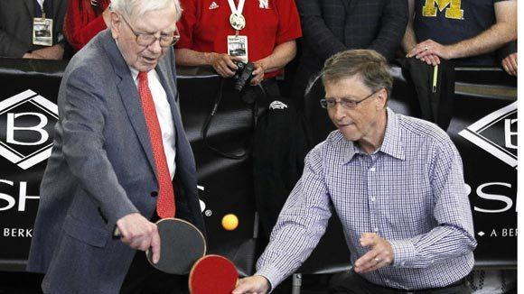 Berkshire Hathaway CEO Warren Buffett, left, plays table tennis with Microsoft Chairman Bill Gates in Omaha, Neb. after Berkshire Hathaway's annual meeting.