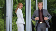 "Guy Pearce, right, as Aldrich Killian and Gwyneth Paltrow as Pepper Potts in ""Iron Man 3."" (Zade Rosenthal / Marvel Entertainment)"