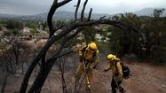 Aided by cooling temperatures and rain, firefighters battling the massive Springs fire in Ventura County have the blaze 80% contained, the Department of Forestry and Fire Protection said Monday.