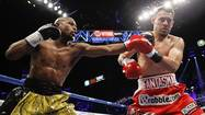 Floyd Mayweather Jr. connects a punch on Guerrero during their title fight at the MGM Grand Garden Arena in Las Vegas