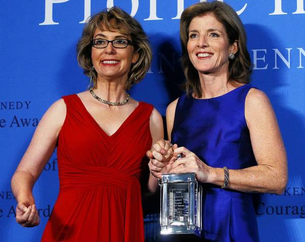Caroline Kennedy Schlossberg (right), daughter of late President John F. Kennedy, on Sunday presents former congresswoman Gabrielle Giffords with the 2013 John F. Kennedy Profile in Courage Award at the Kennedy Library in Boston.