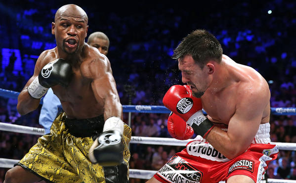 World Boxing Council champion Floyd Mayweather (L) and Robert Guerrero exchange punches during their fight at the MGM Grand Garden Arena in Las Vegas on May 4, 2013. Mayweather extended his perfect record to 44 victories, beating Robert Guerrero by unanimous decision in their welterweight title fight.