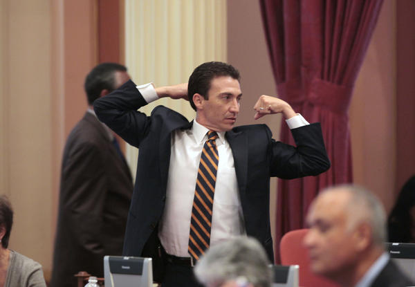 Former State Senator Michael Rubio, D¿Bakersfield, stretches during a lull in the legislative action at the Capitol last August.