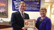 First Command Financial Planning has been awarded Hampton Roads Magazine¿s readers¿ choice award as ¿Best Financial Planners¿ in the region. District Advisor Rick Batten accepts this year¿s plaque from Hampton Roads Magazine¿s Brenda Whitlow.