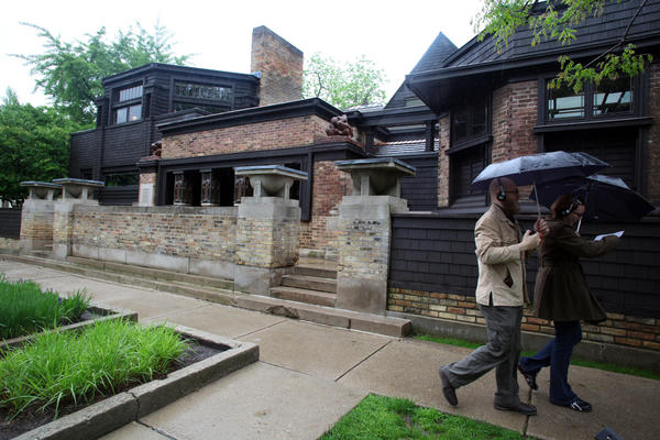 Alex Daniel, left, and his girlfriend Sydney Shafer, of Champaign, take an audio tour of the Frank Lloyd Wright Home and Studio and nearby Wright-designed homes on May 7, 2012 in Oak Park.