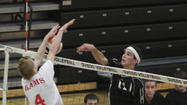 Sean Mullen (4) leads Lake Mary against Bishop Moore in Tuesday's boys volleyball region final.