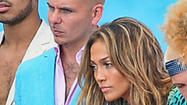 Jennifer Lopez and Pitbull were bringing a buzz to Fort Lauderdale beach Sunday, dancing and lip-syncing and just being their A-list celebrity selves when gunshots rang out.