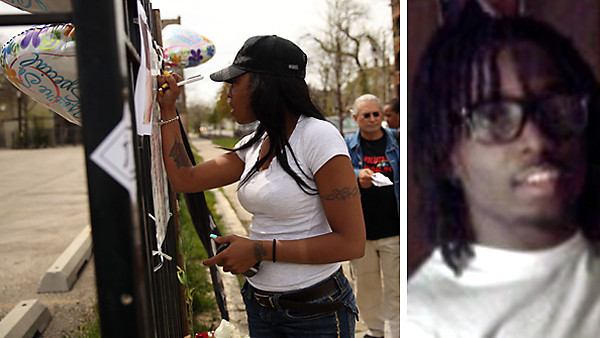 Tracy Smith signs a memorial in the 1300 block of South Independence Boulevard in Chicago for Tywon Jones, right, who was reportedly shot and killed by Ogden District tactical officers at that location a day earlier.