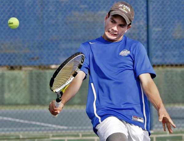 San Marino High School's tennis player James Wade returns the ball during doubles match at home vs. La Canada High School in San Marino on Thursday, March 28, 2013. (Raul Roa/Staff Photographer)