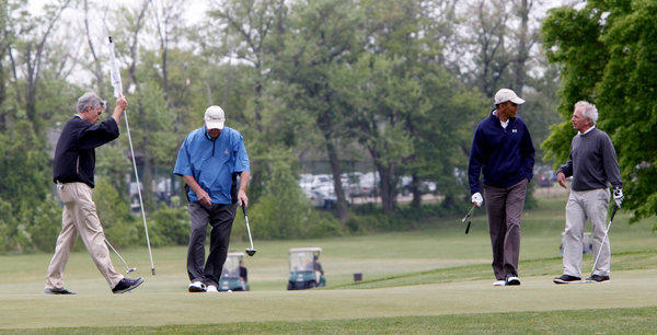 President Barack Obama, second from right, plays golf with, from left, Sen. Mark Udall (D-Colo.), Sen. Saxby Chambliss (R-Ga.) and Sen. Bob Corker (R-Tenn.) at Andrews Air Force Base.