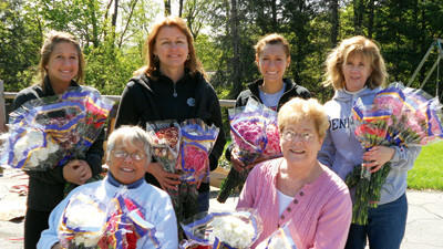 Volunteers pose with their bouquets at last years Birthright Mothers Day Carnation event.