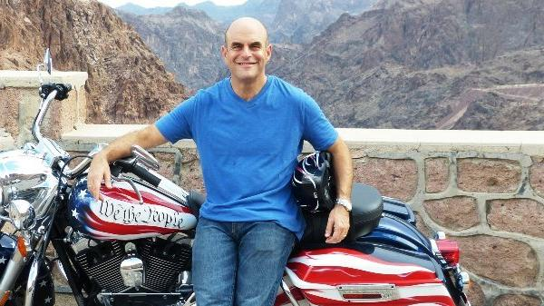 """Peter Sagal, host of NPR's """"Wait, Wait ... Don't Tell Me,"""" travels cross-country on a customized Harley-Davidson to find out what the Constitution means in the 21st century."""